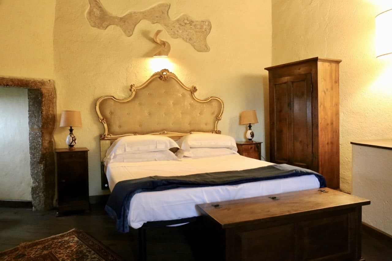 The chic suite at Hotel della Fortezza is located inside the village's ancient fortress.
