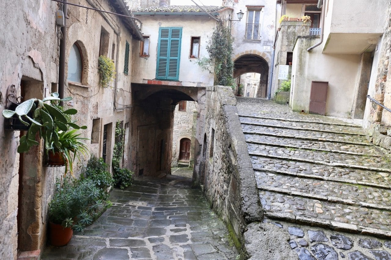 Enjoy a stroll through ancient cobblestone streets in Sorano Italy.