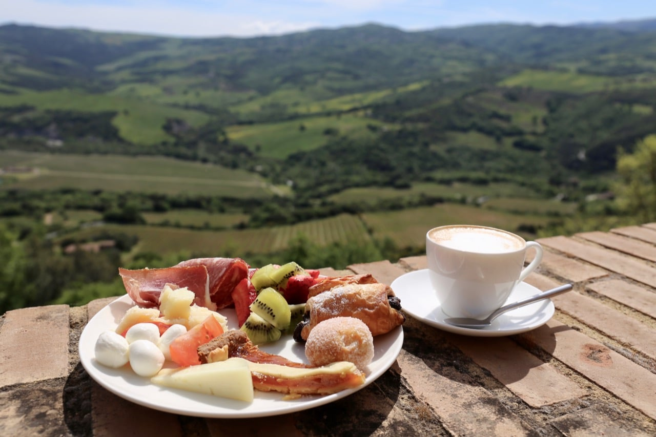Tuscan breakfast with a panoramic view at Castello Di Velona Resort.