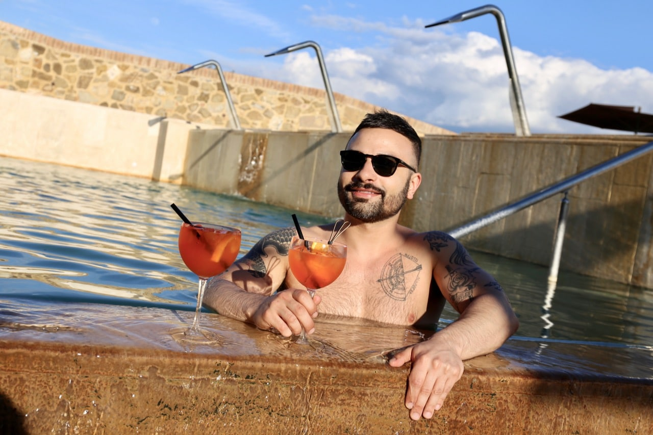 Enjoy Aperol Spritz cocktails in the hotel's pool during sunset.