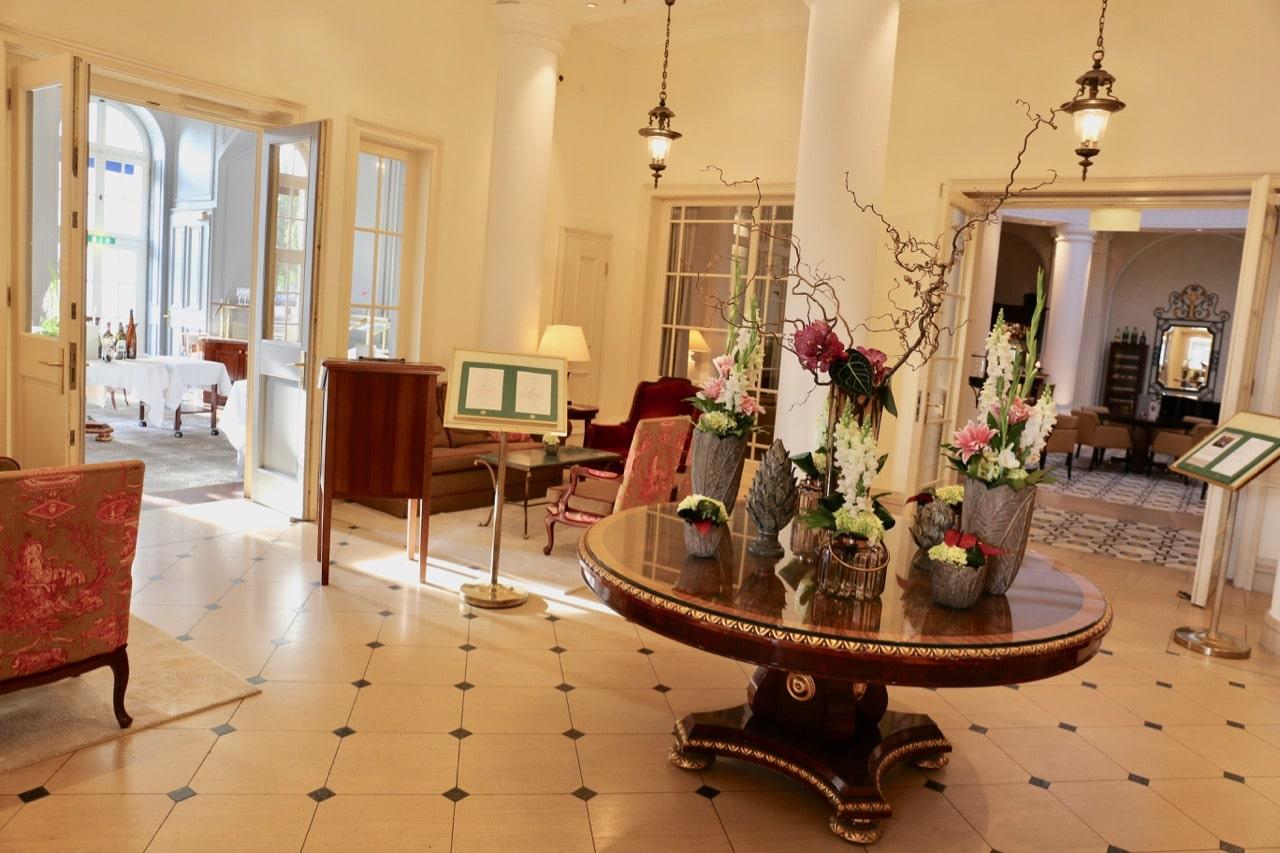 Fresh flower arrangements greet guests at the Furstenhof Hotel lobby.