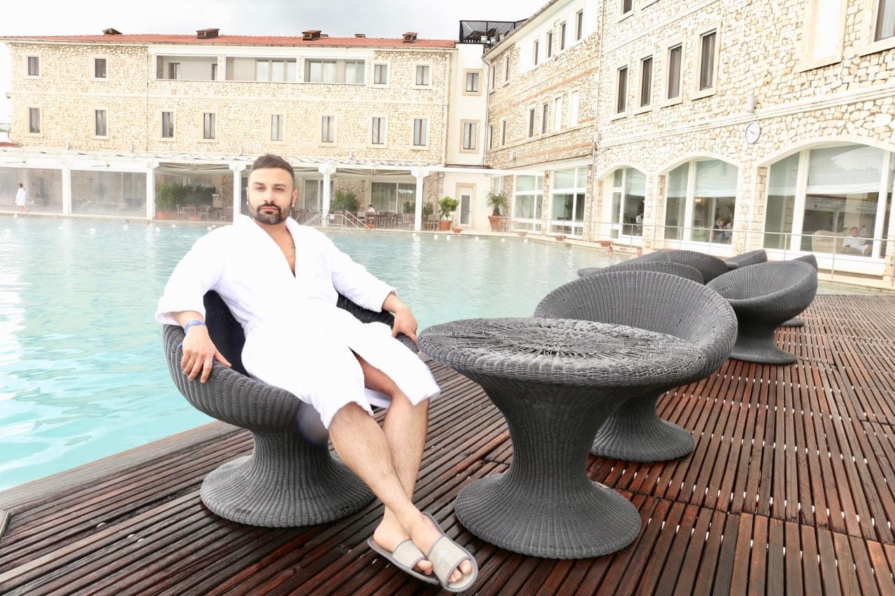 Enjoy a luxurious wellness getaway at Terme di Saturnia Resort's outdoor thermal pool.