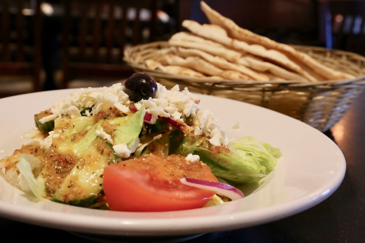 Agabi Oakville' Greek salad served with a basket of pita.