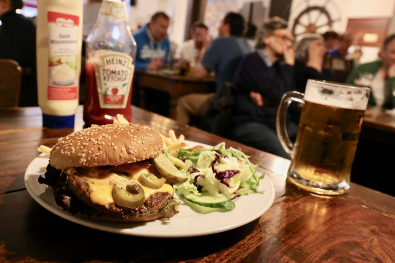 Join locals for a hamburger feast in Hamburg at Frau Moller restaurant.