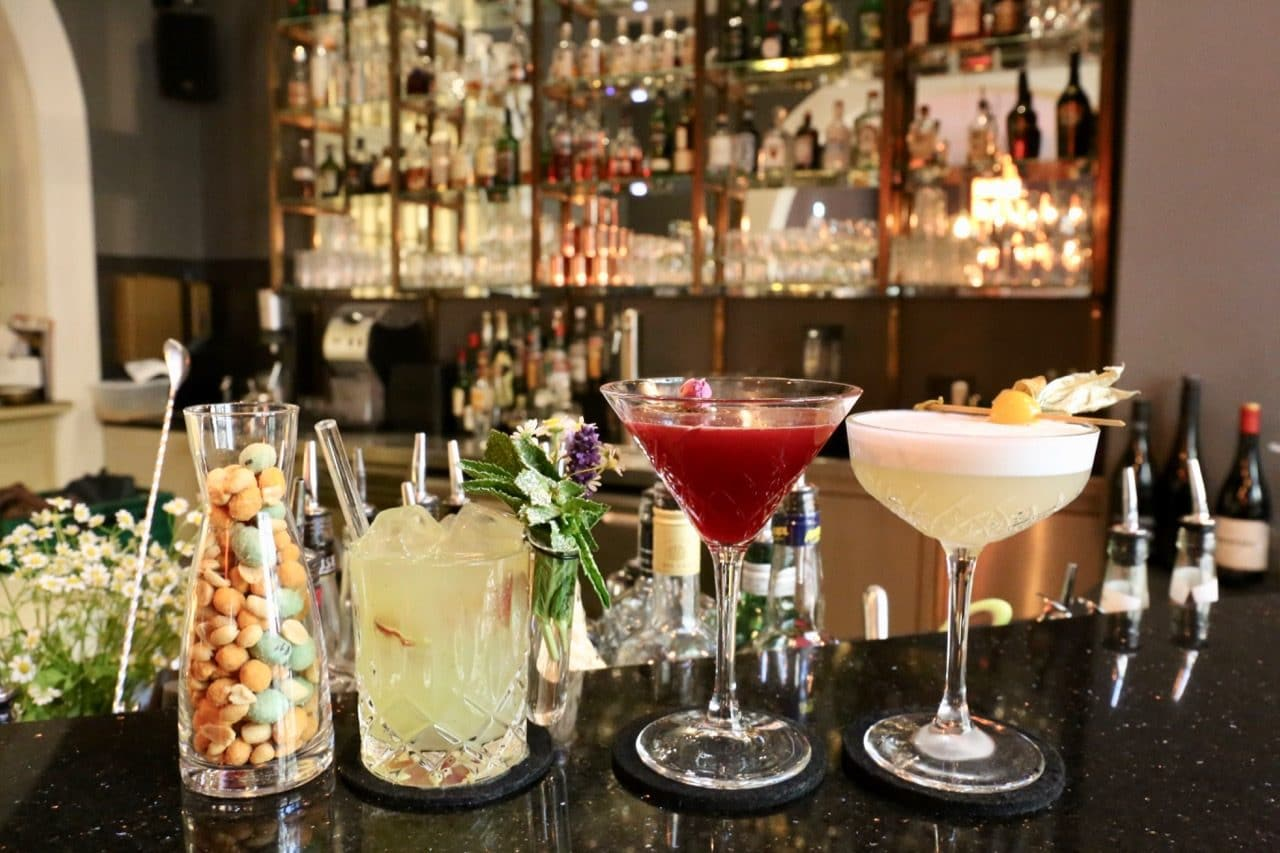 Nibble on bar snacks and sip a parade of craft cocktails The Kaminabar.