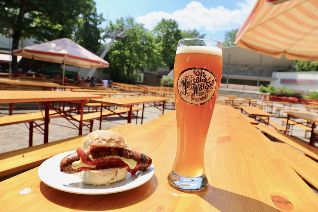 Enjoy an al fresco Berlin food feast featuring sausages and beer at Prater Garden.