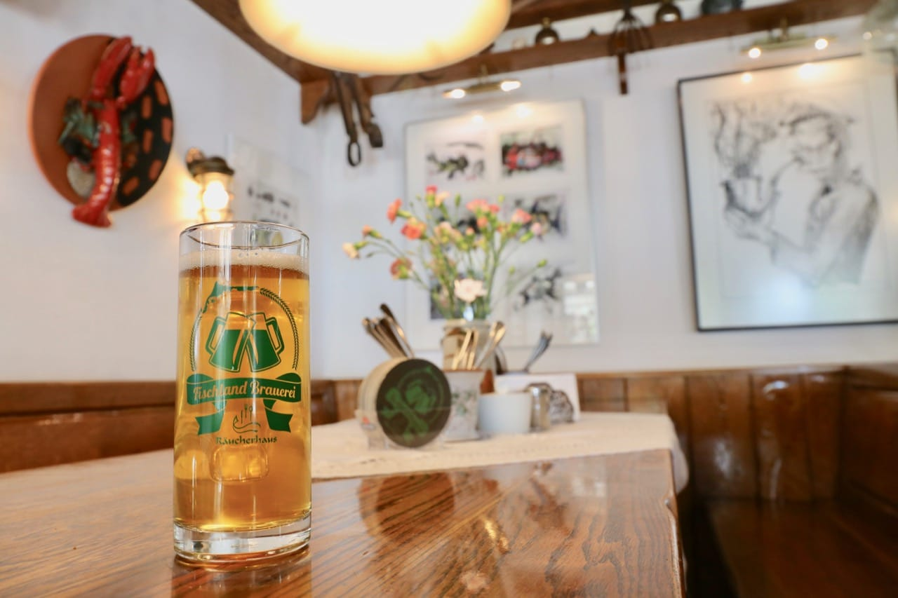 Sip local craft beer at Raucherhaus, a restaurant overlooking Ahrenshoop's harbour.