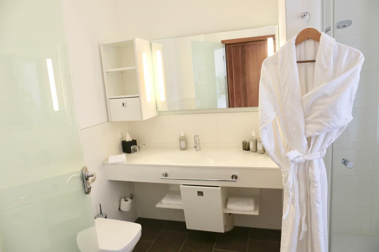 The Grand Ahrenshoop's bathrooms are bright white and include comfy bath robes.