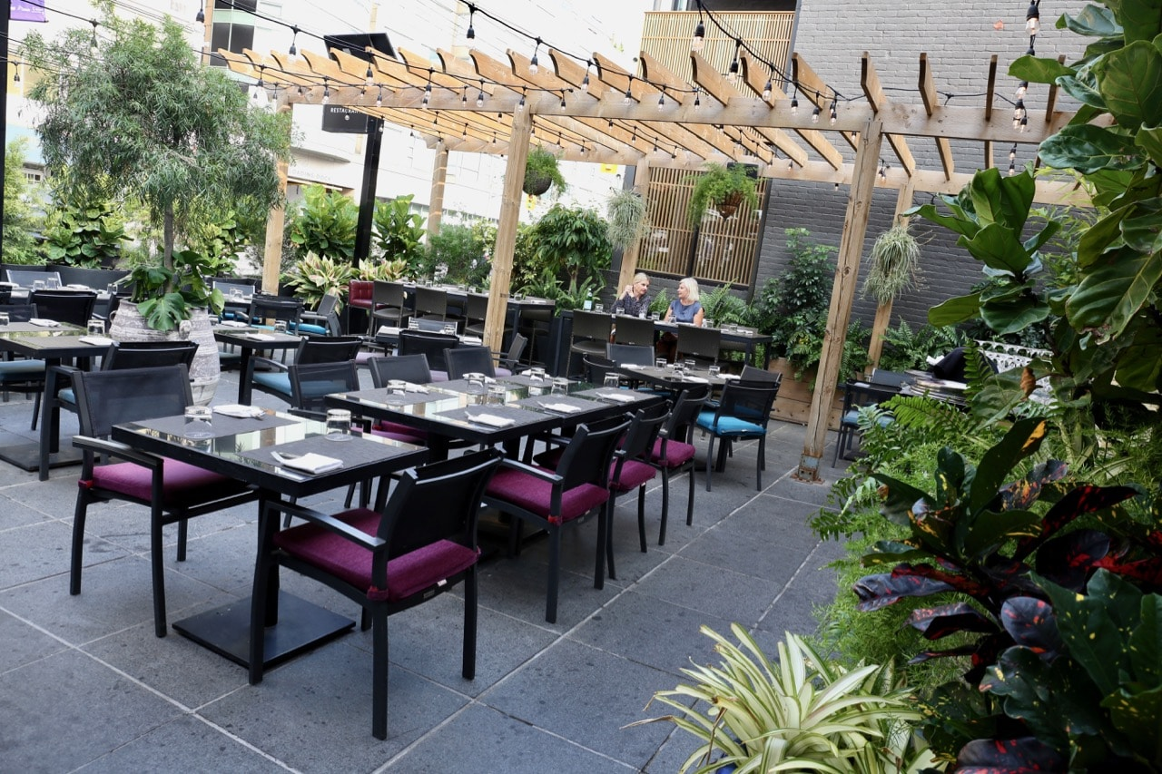 Estia Toronto's patio sits in a Mediterranean garden, perched over Avenue Road.