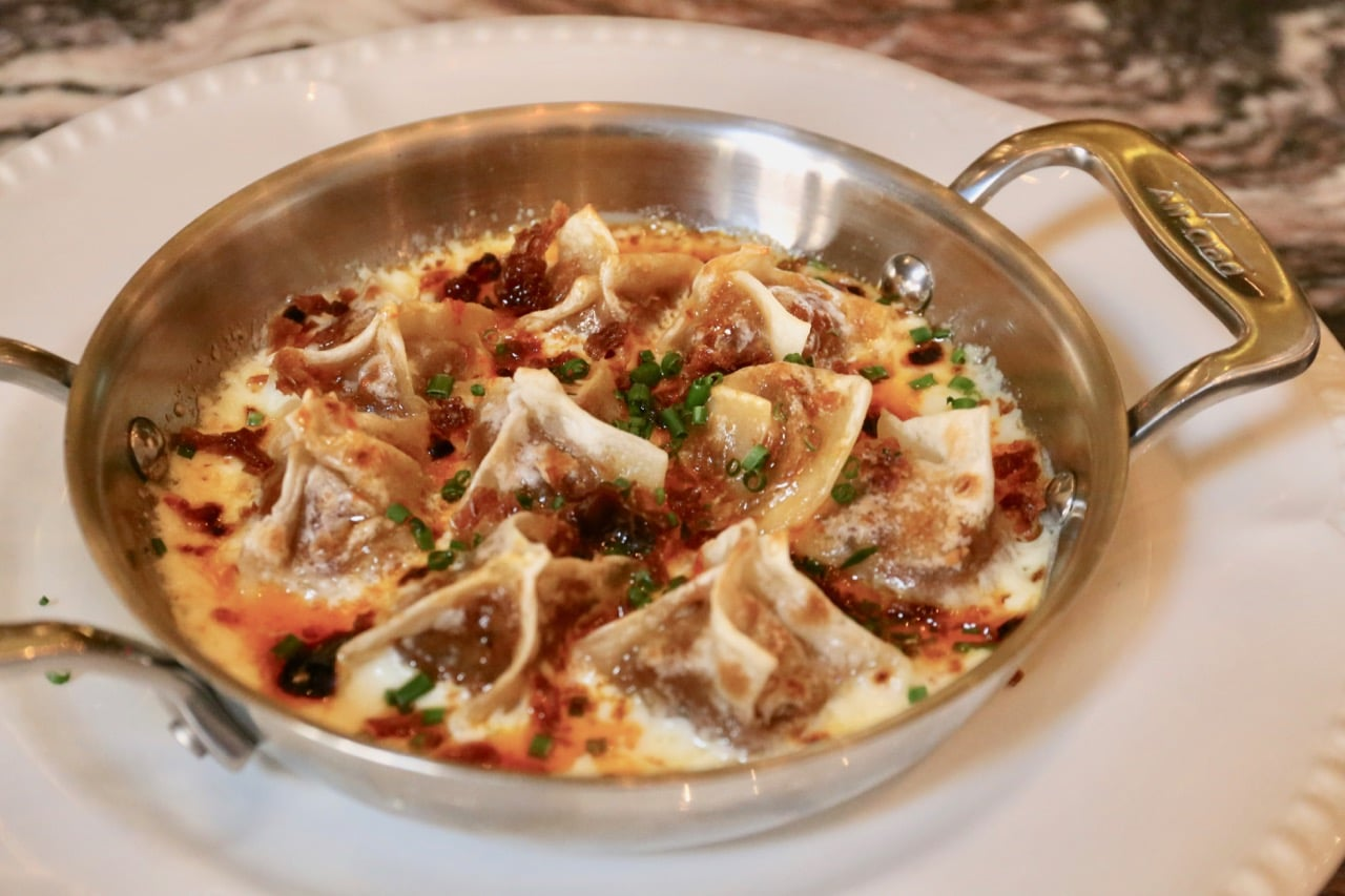 Estia Toronto's signature Oxtail Manti Dumplings with chili butter and yogurt sauce.