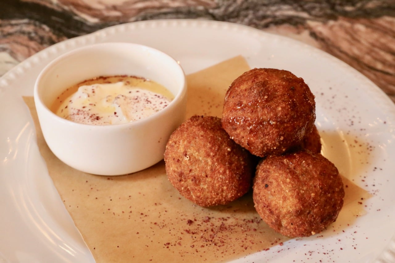 Wagyu Beef Kibbeh are served with truffle labneh and warm honey.