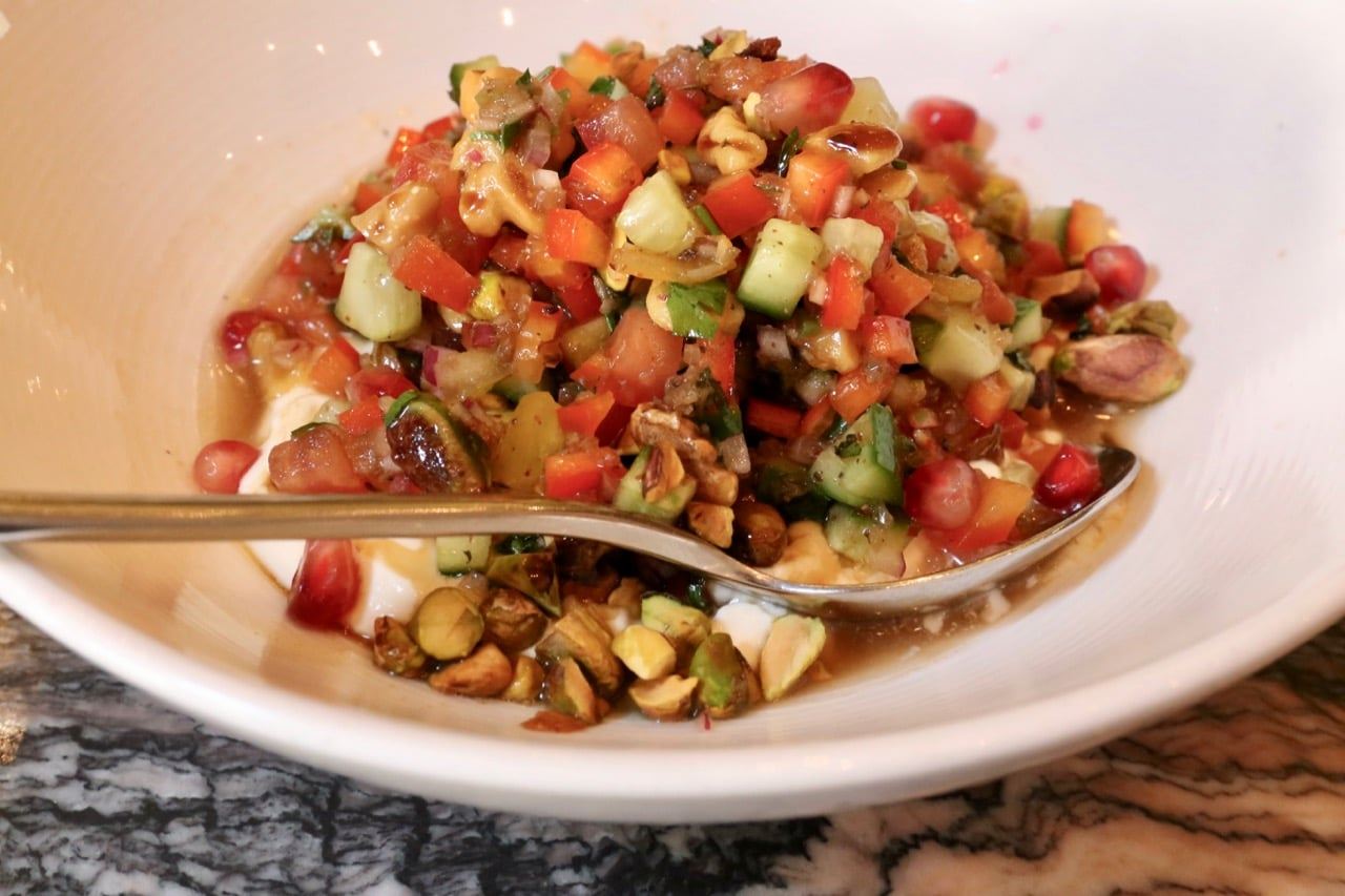 Vegetarian Turkish Spoon Salad features walnut, pistachio, labneh and pomegranate vinaigrette.