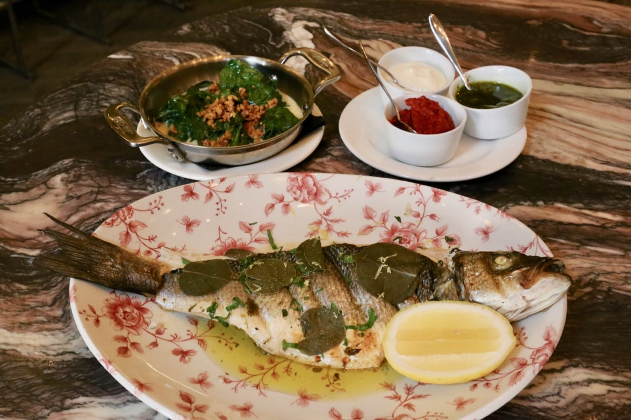 The daily fish option offers a whole fish filleted table-side.