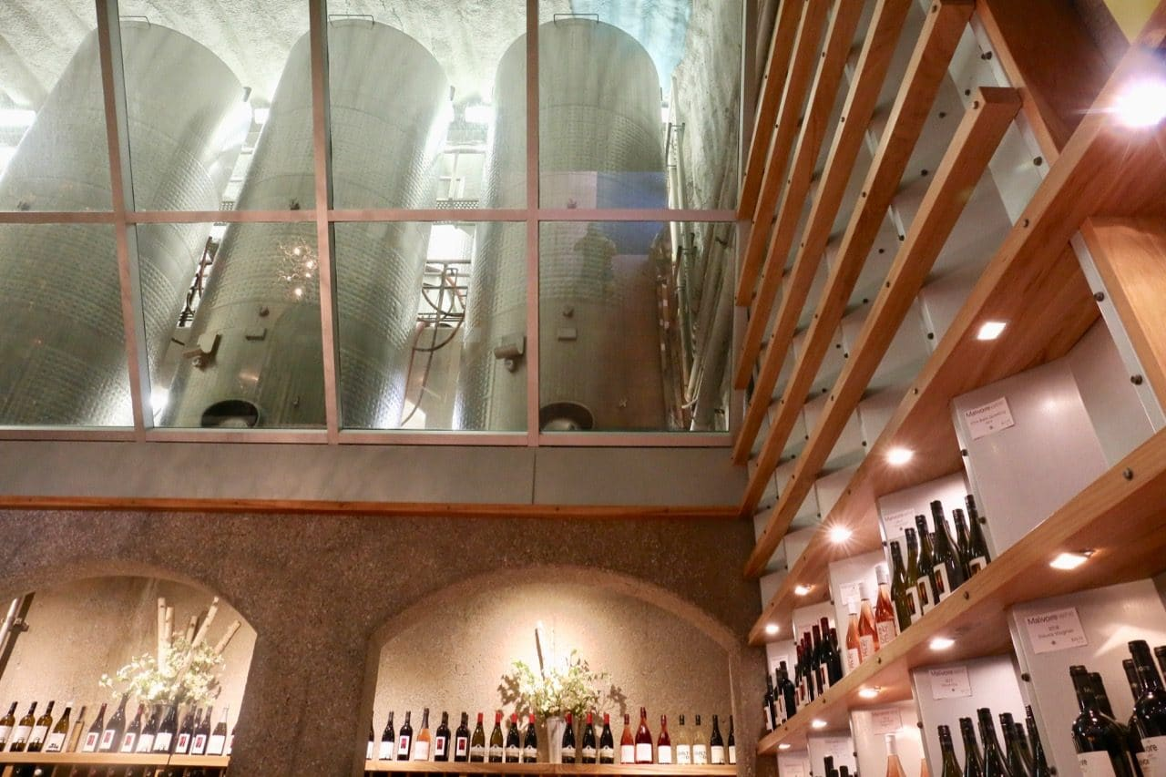 Look up at a choir of fermentation tanks at Malivore Wine Company's tasting room and retail store.