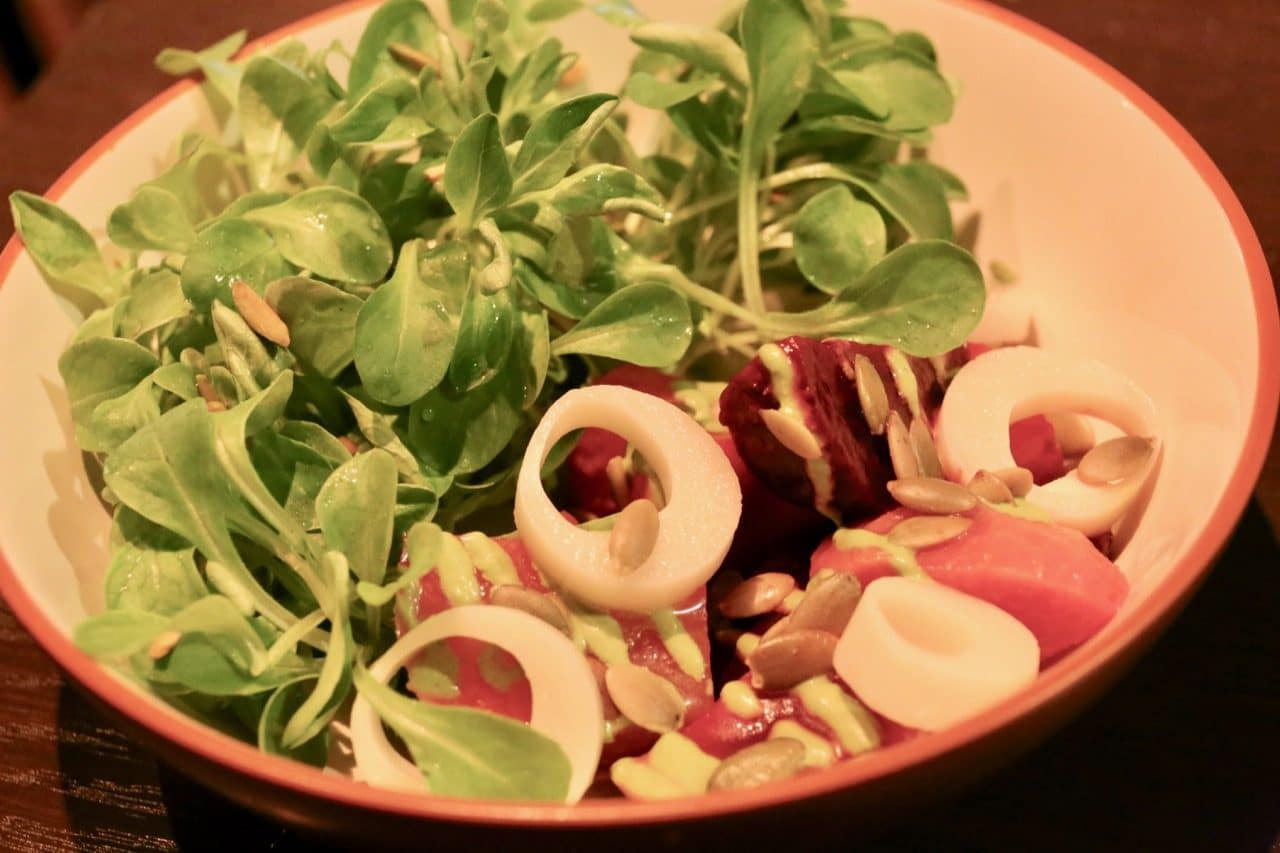 Ensalada de Remolacha features baby beet and hearts of palm.