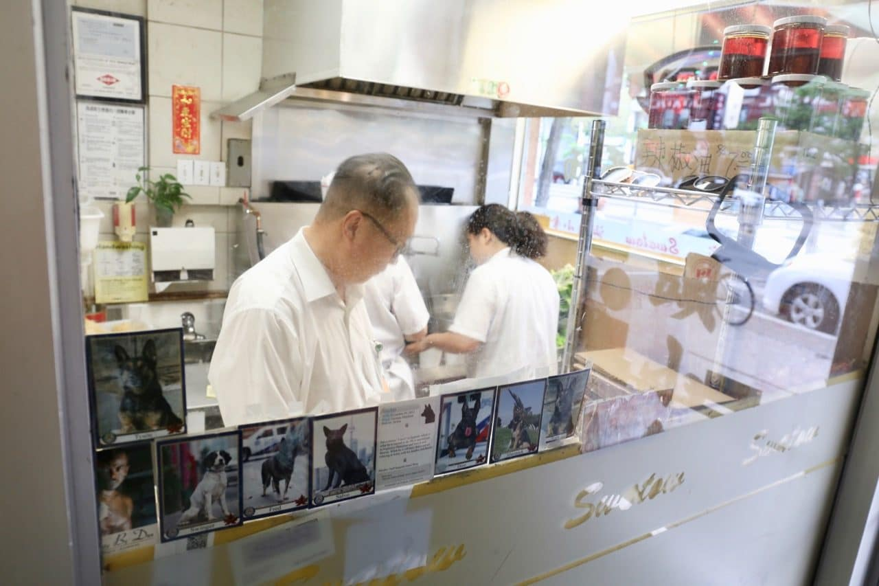 Those waiting for take out orders can peak into Swatow Toronto's Chinese restaurant kitchen.