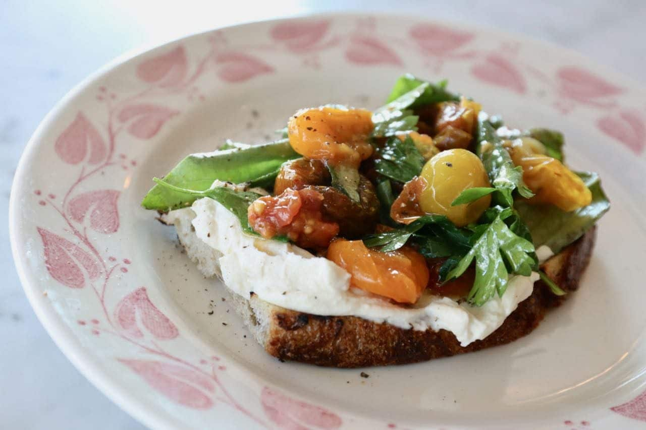 Bar Vendetta's Bruschetta with smoked ricotta, preserved tomatoes and herbs.
