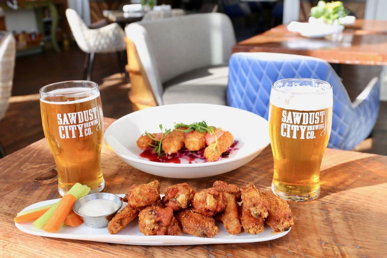 Sip local craft beer alongside a plate of chicken wings at JW Marriott Muskoka's Lakes Bar.