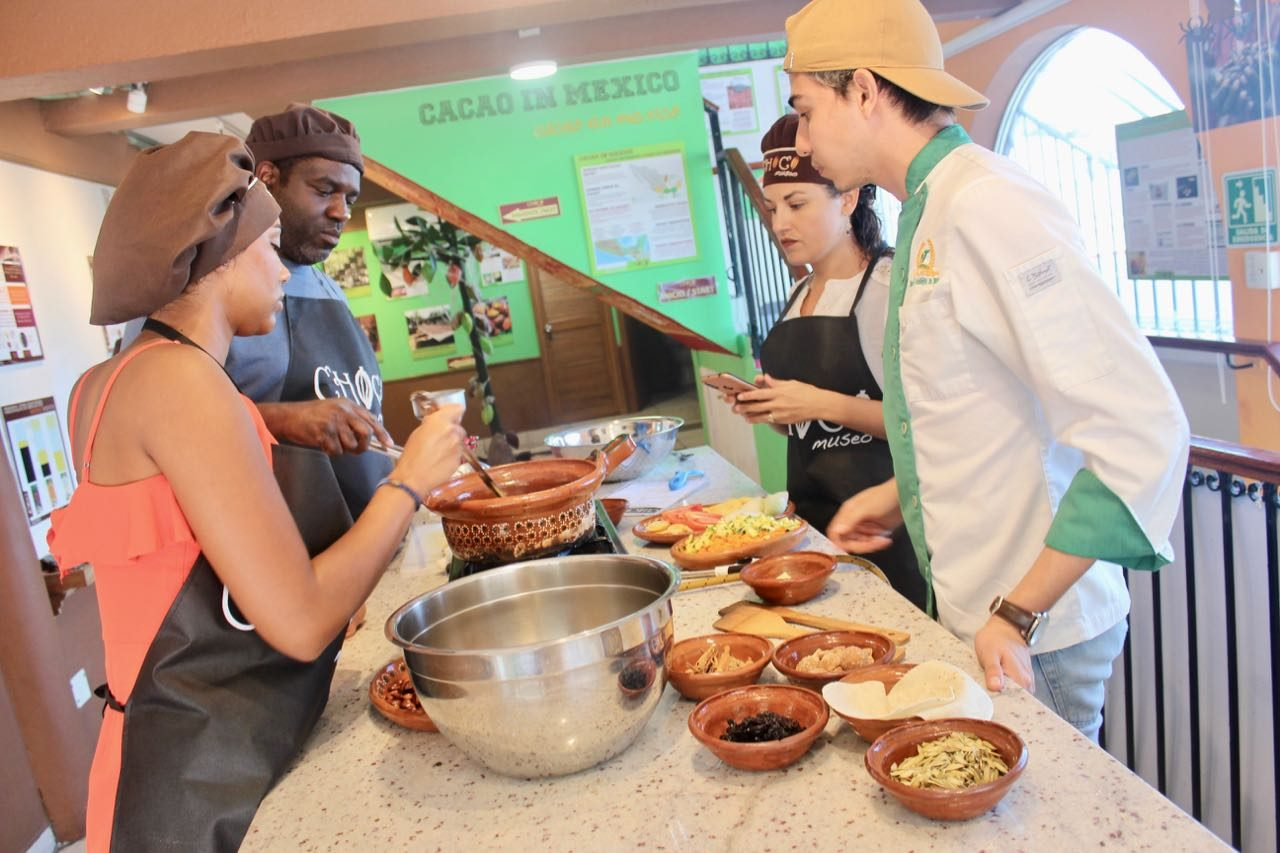 Book a cooking class at ChocoMusuem to learn how to make mole.