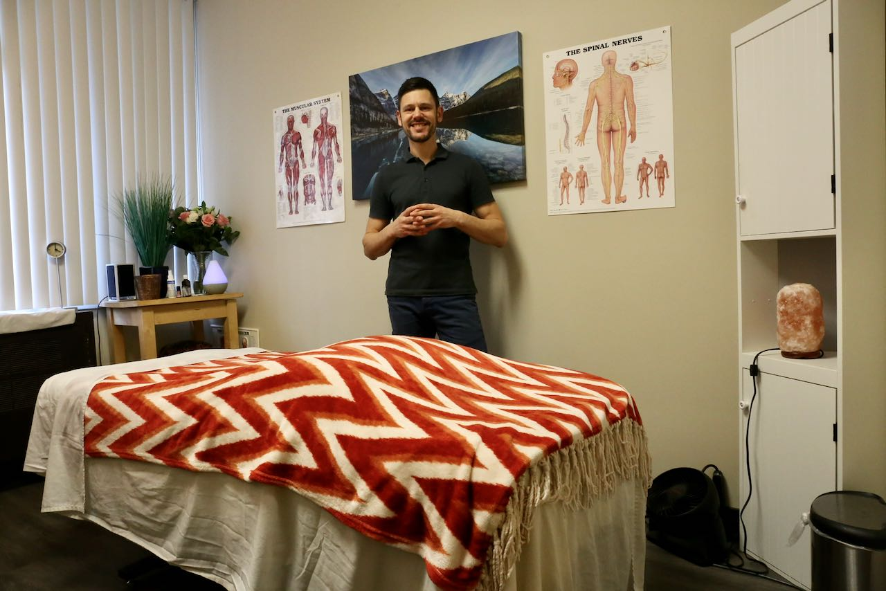 Registered Massage Therapist Andrew Dube at Aches Away Toronto near College Station.