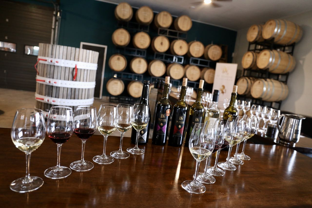 Enjoy a wine tasting in the barrel room at De Simone Vineyards.