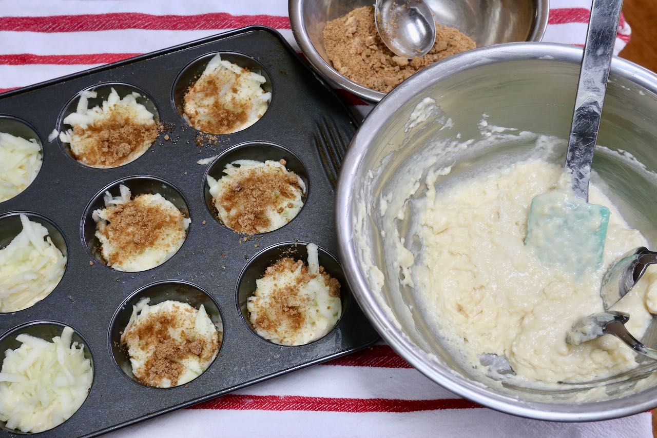 These muffins are stuffed with a secret surprise featuring grated apple and cinnamon sugar.
