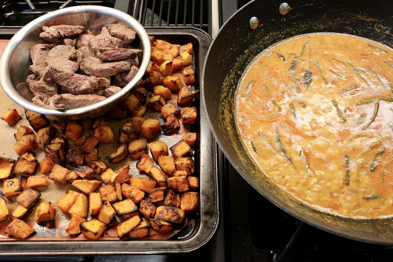 Add roasted pumpkin and sautéed beef to Thai red curry sauce.
