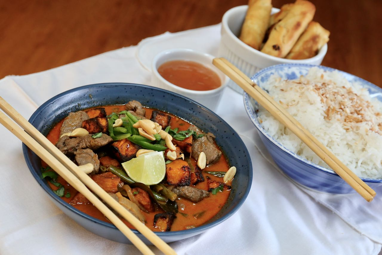 Serve Beef and Pumpkin Curry with coconut rice and spring rolls.
