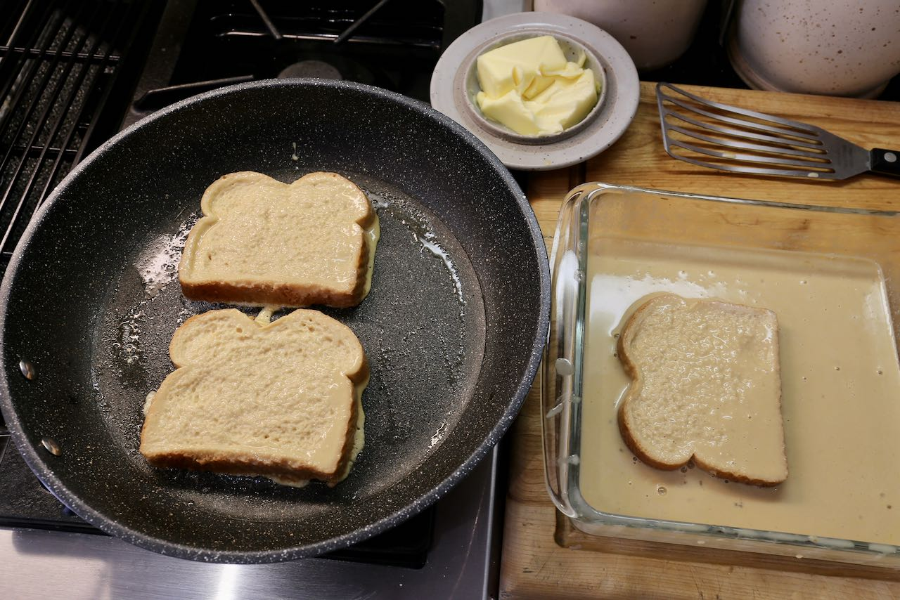 Fry French Toast in butter inside a non-stick frying pan.
