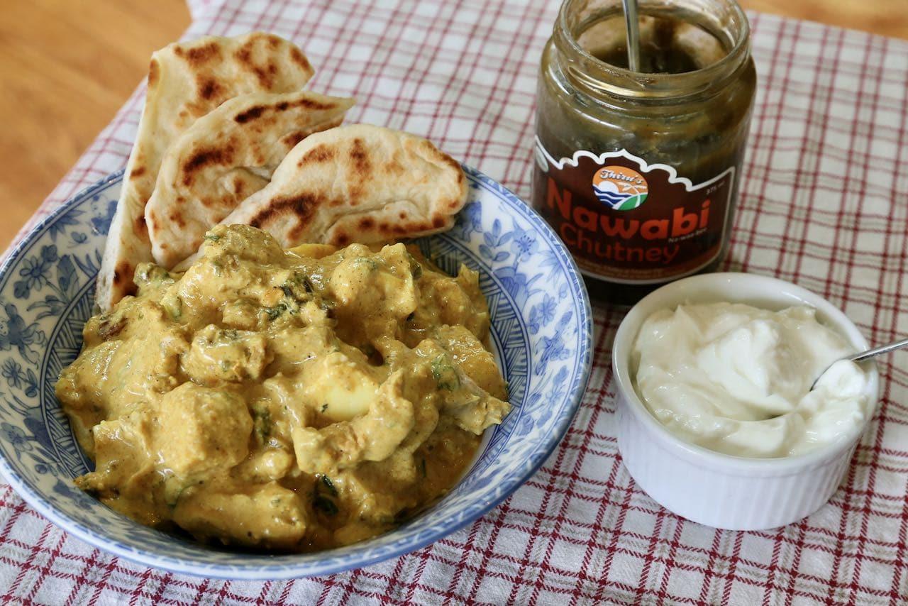 Serve Chicken Shahi Korma with nann, yogurt and sweet chutney.