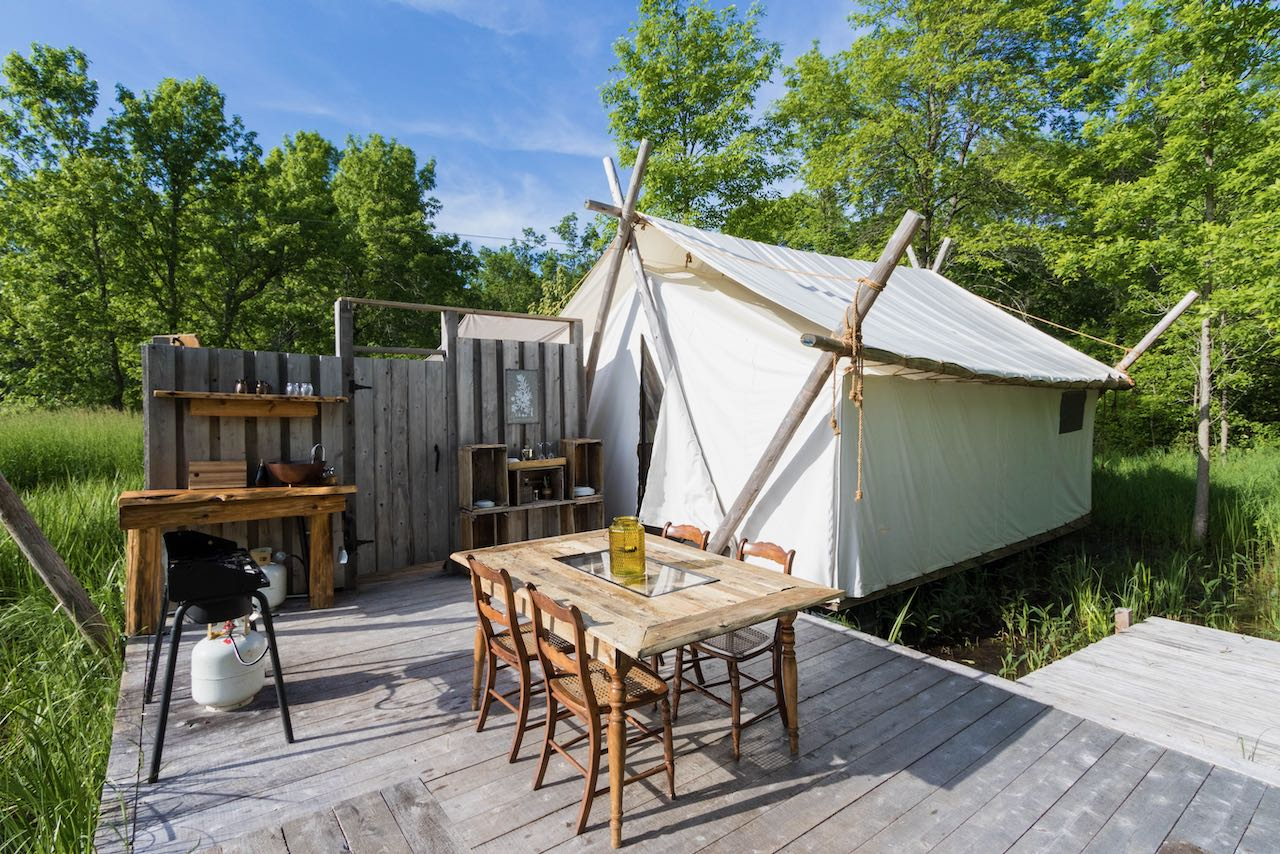 Fronterra Glamping tent and outdoor kitchen in Prince Edward County, Ontario.