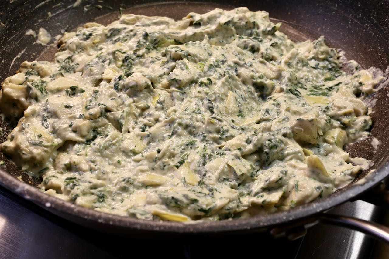 This homemade dip is made of spinach, cheese, sour cream and artichokes.