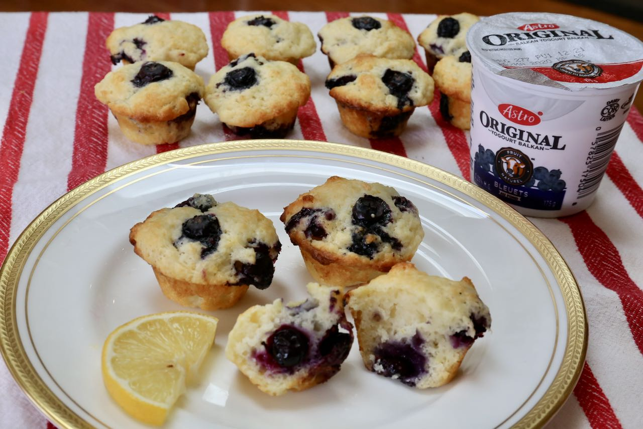 Serve Mini Blueberry Muffins with a slice of lemon and yogurt for breakfast.