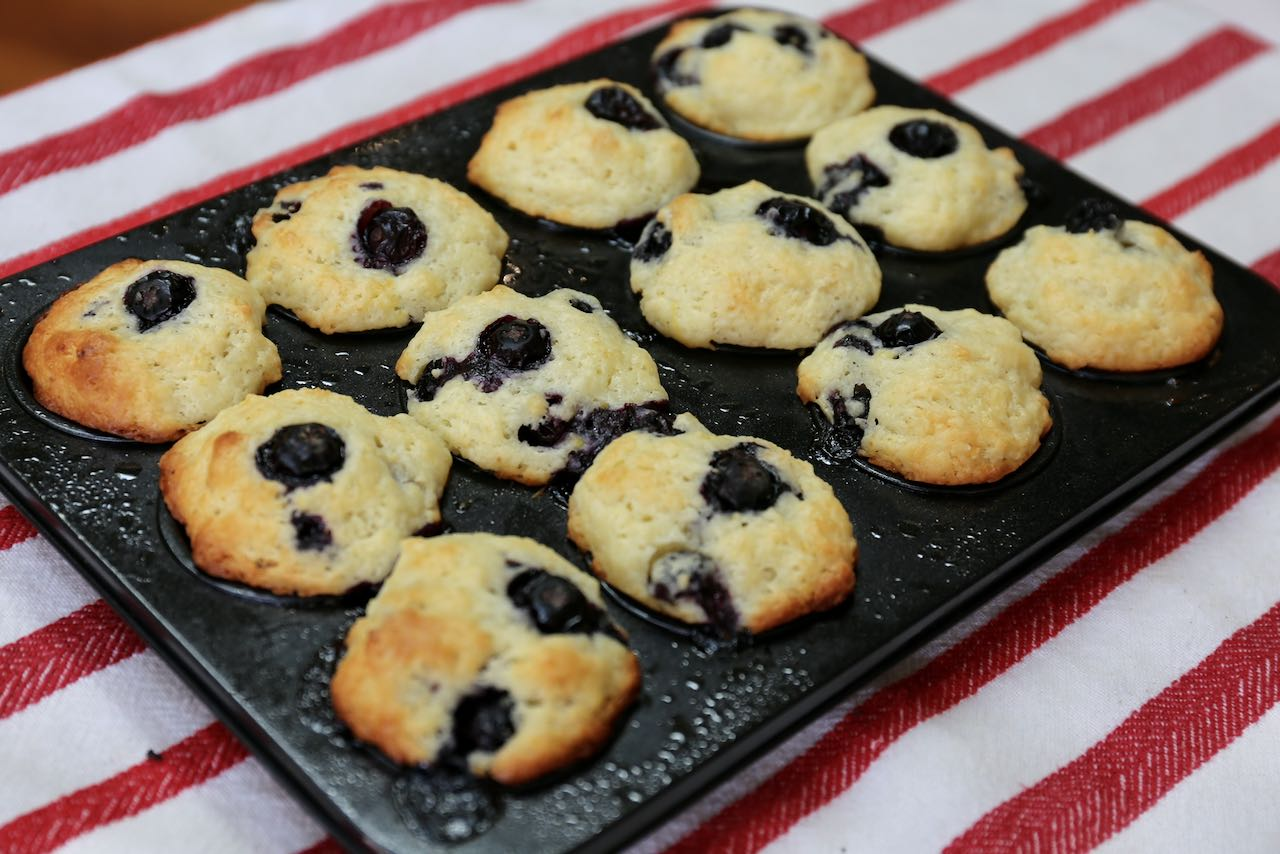 Mini Blueberry Muffins should be baked until golden brown.