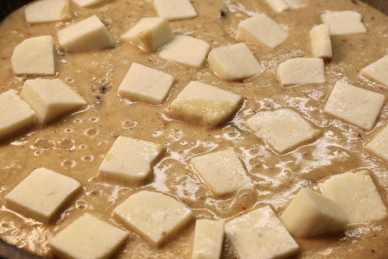 Finish our Shahi Paneer recipe by adding cubes of Indian cottage cheese.