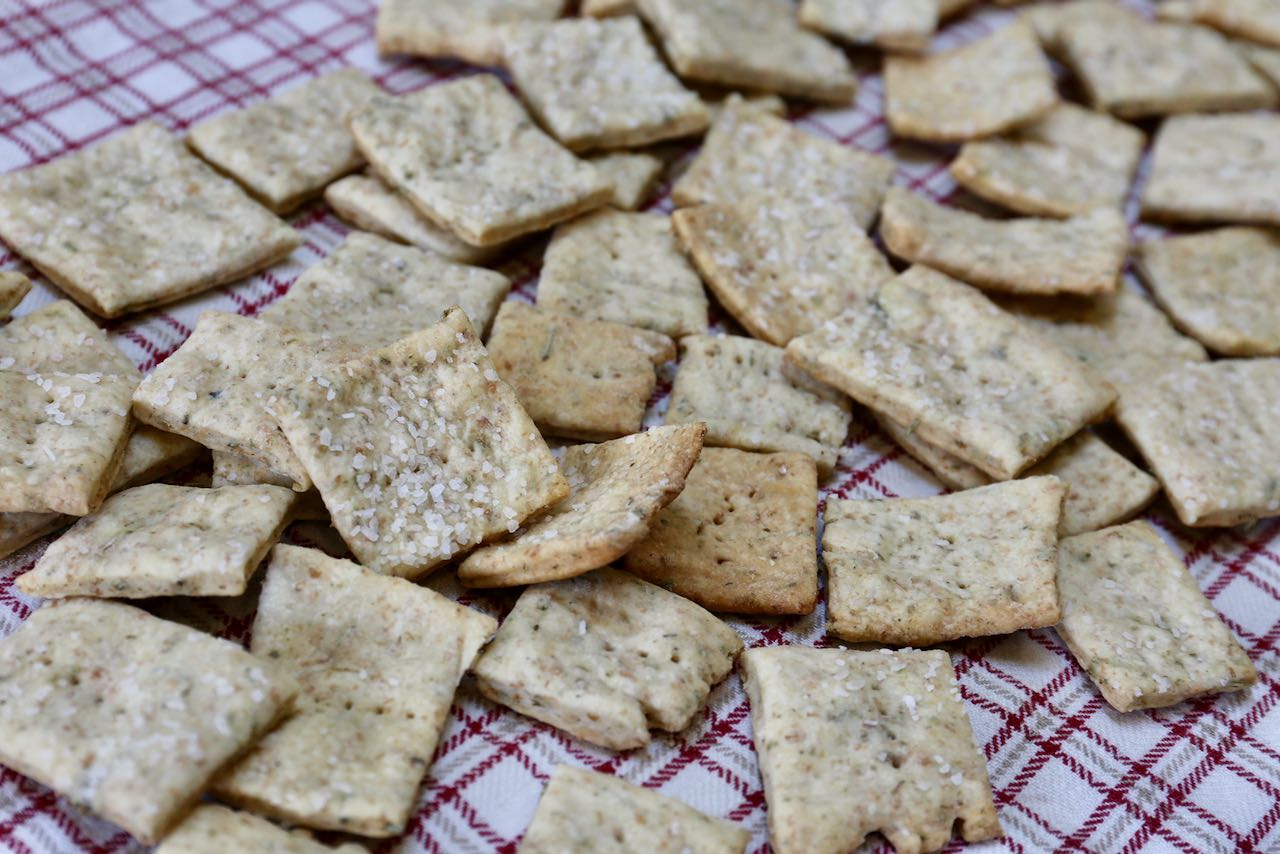 Homemade crackers taste similar to Wheat Thins and are by far one of the easiest Sourdough Discard Recipes.