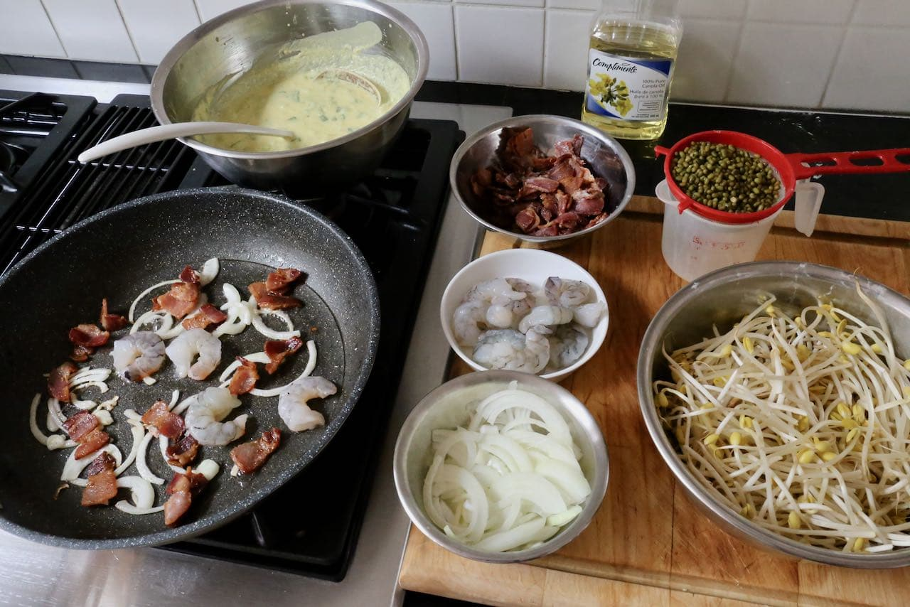 Vietnamese  Crepe Step 1: Fry onion, bacon and shrimp in non-stick pan over medium heat.