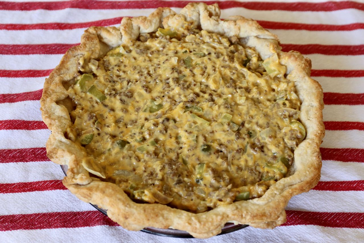 Use a spatula to scoop and smooth over pickle filling into pre-baked pie crust.