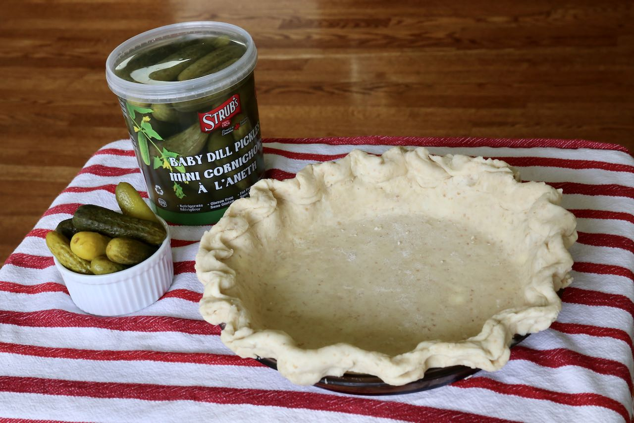 Pre-bake a pie crust before making your Pickle Pie filling.