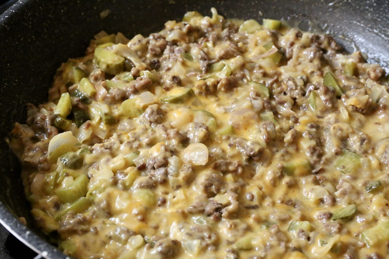 Pickle Pie filling is finished once fully combined and cheese has melted.