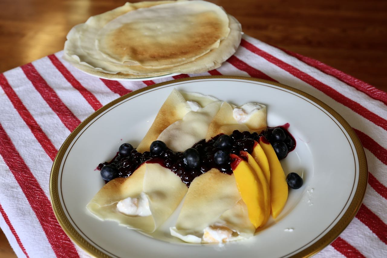 Stuff crepes with coconut flour with mango cottage cheese and top with blueberry sauce.