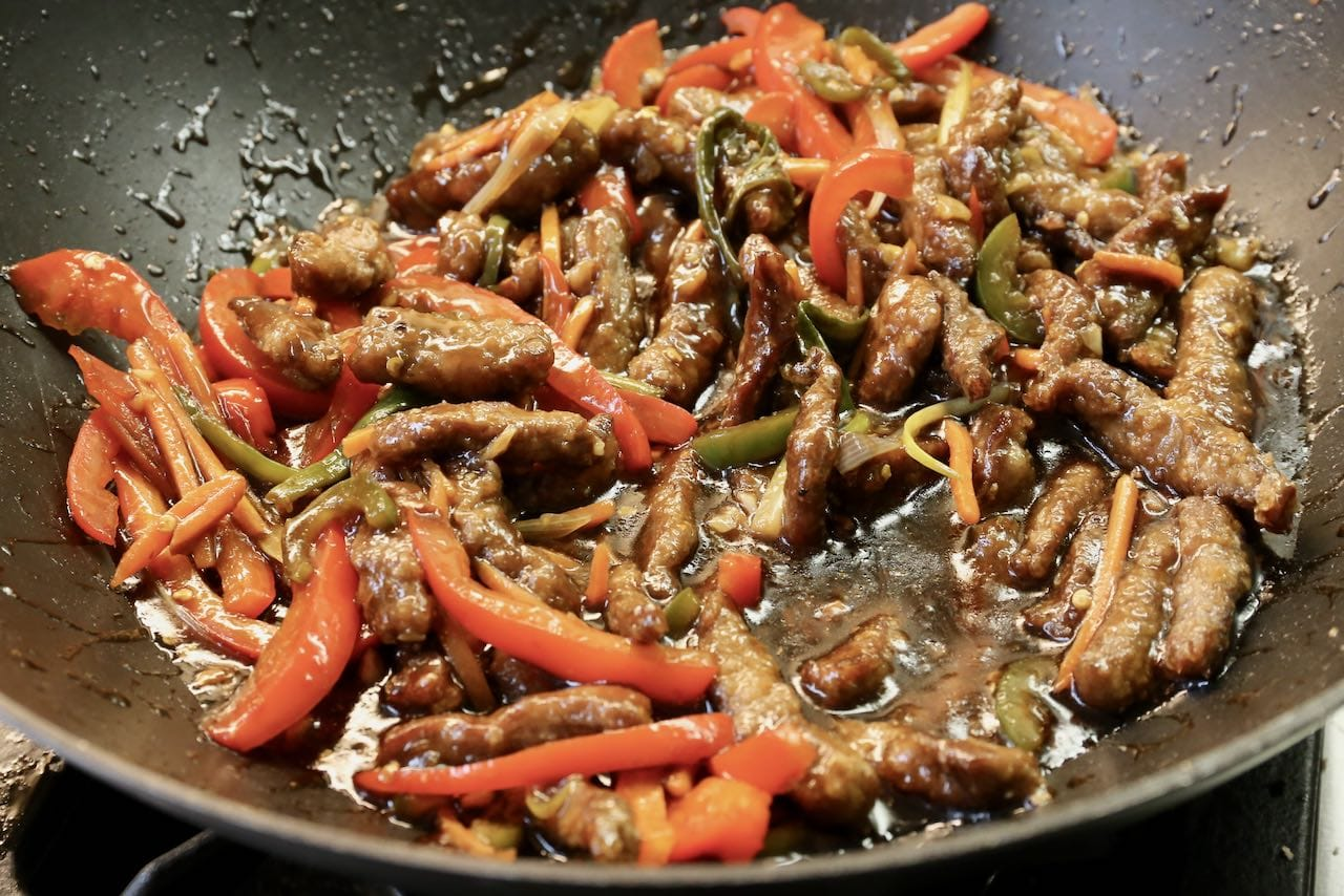 Calgary Ginger Beef: Add flank steak strips to sautéed vegetables and reduce sauce until a thick gravy.