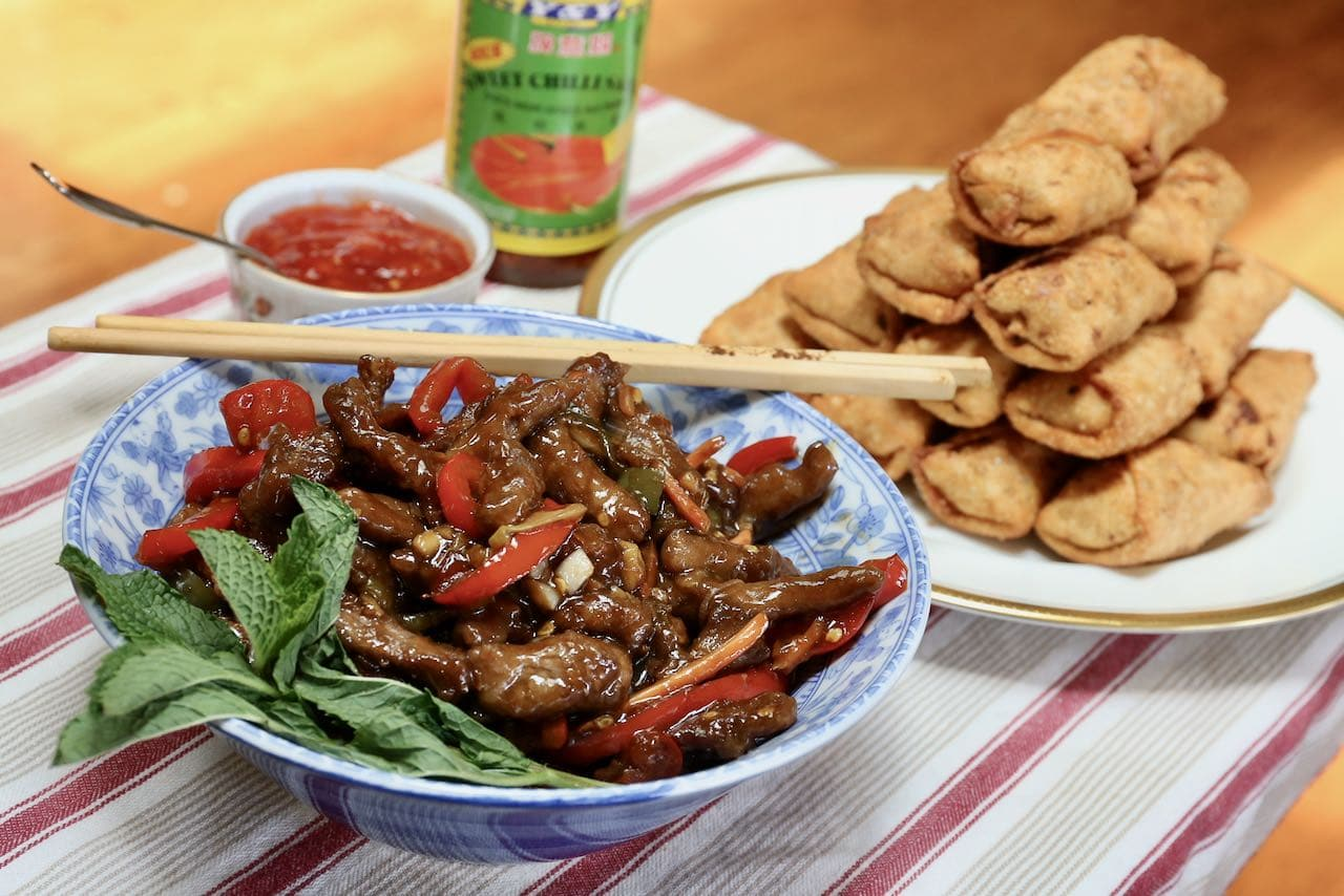 Serve Calgary Ginger Beef with spring rolls and Thai sweet chili sauce.