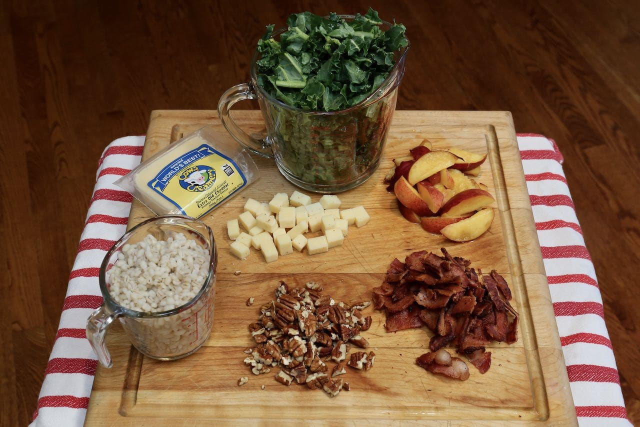 Canadian Salad: Chopped kale, cheese cubes, cooked barley and sliced pecans, bacon and peaches.