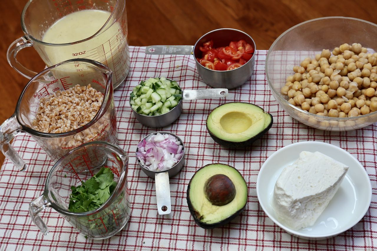 Use fresh vegetables and herbs when making Healthy Garlic Lemon Chickpea Avocado Salad.