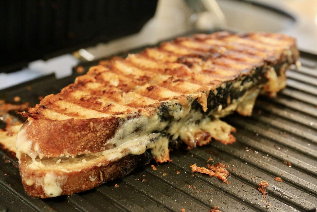 Gruyere grilled cheese is finished cooking once golden brown and crispy.