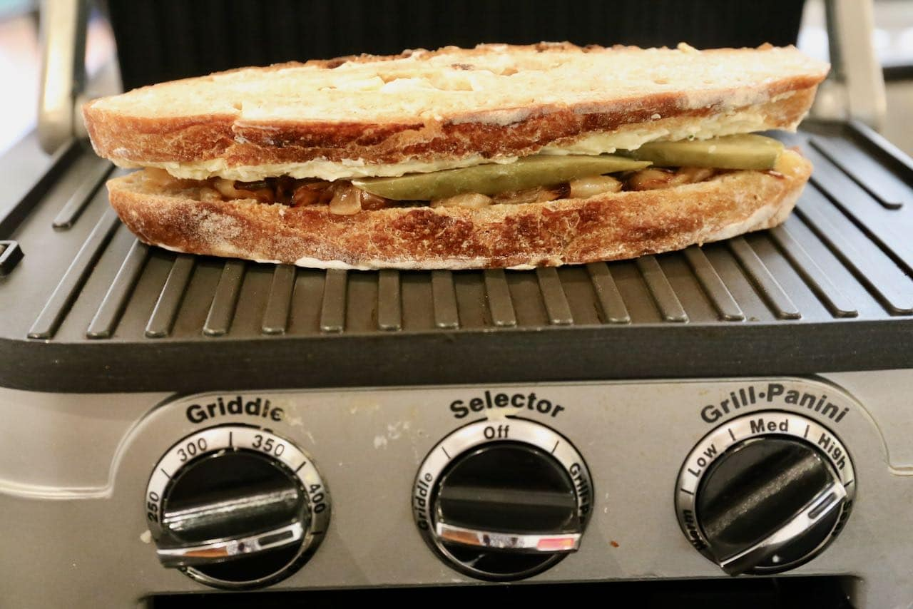 Grill Crispy Gruyere Grilled Cheese in a panini grill.