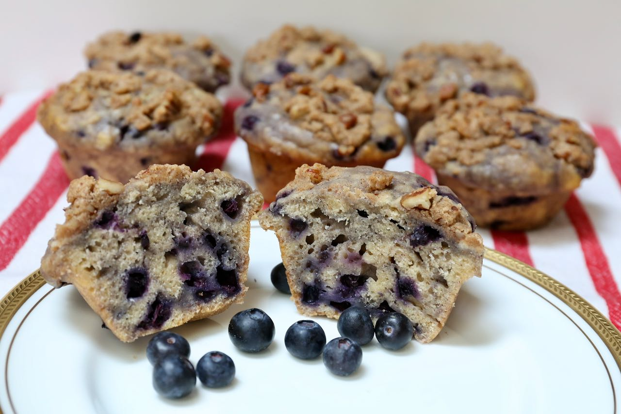 Serve muffins with fresh blueberries and yogurt for breakfast.