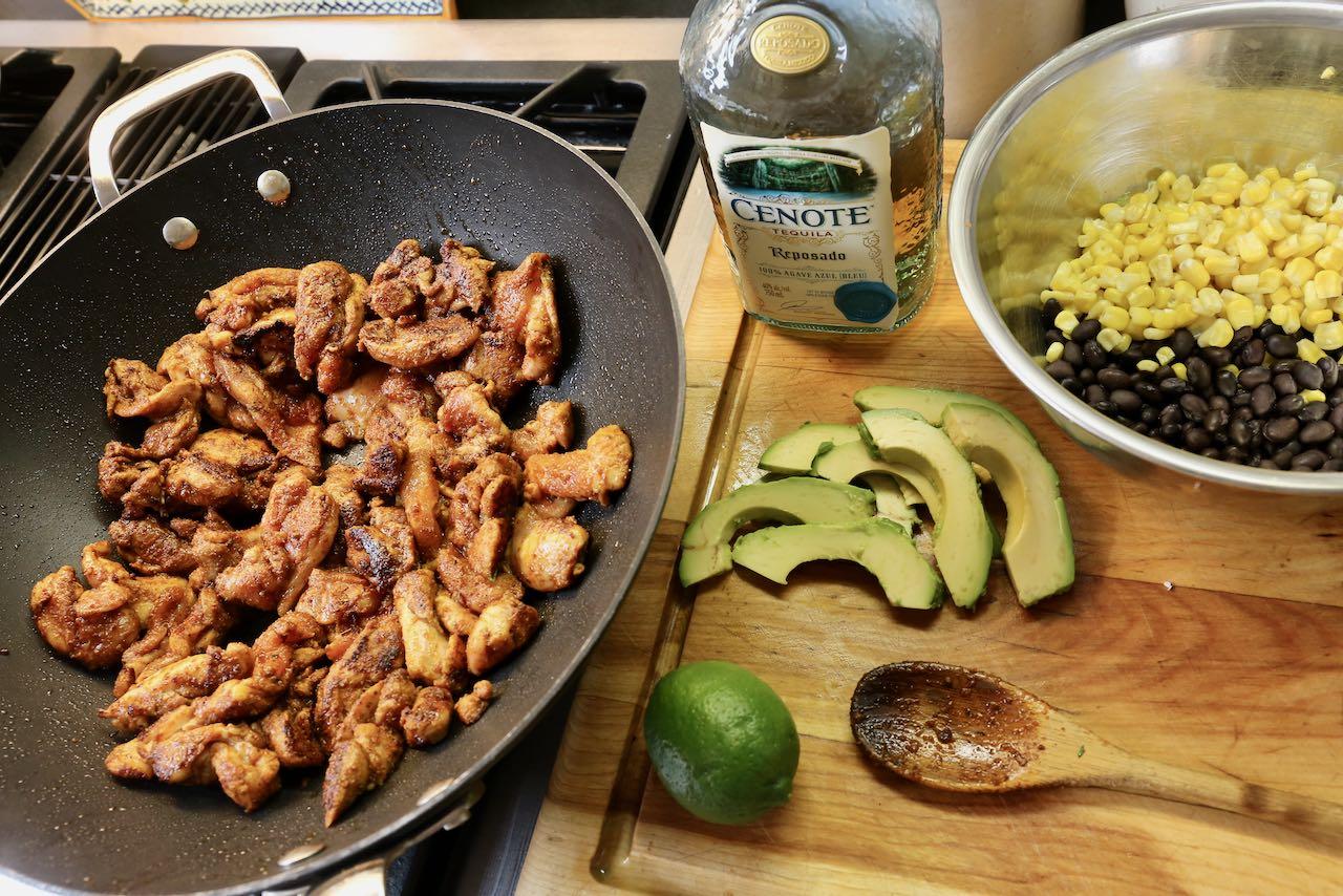 Prepare the filling for chicken fajita tacos in a wok or large non-stick skillet.
