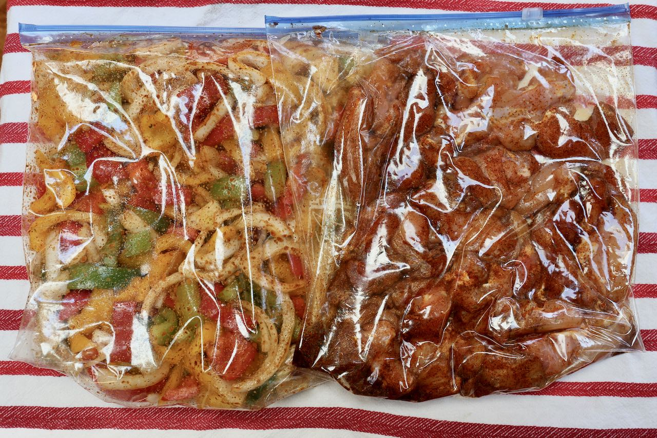 Let mixed vegetables and sliced chicken marinated in spice mix in ziplock bags in the fridge.